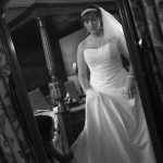 Bride views dress in mirror