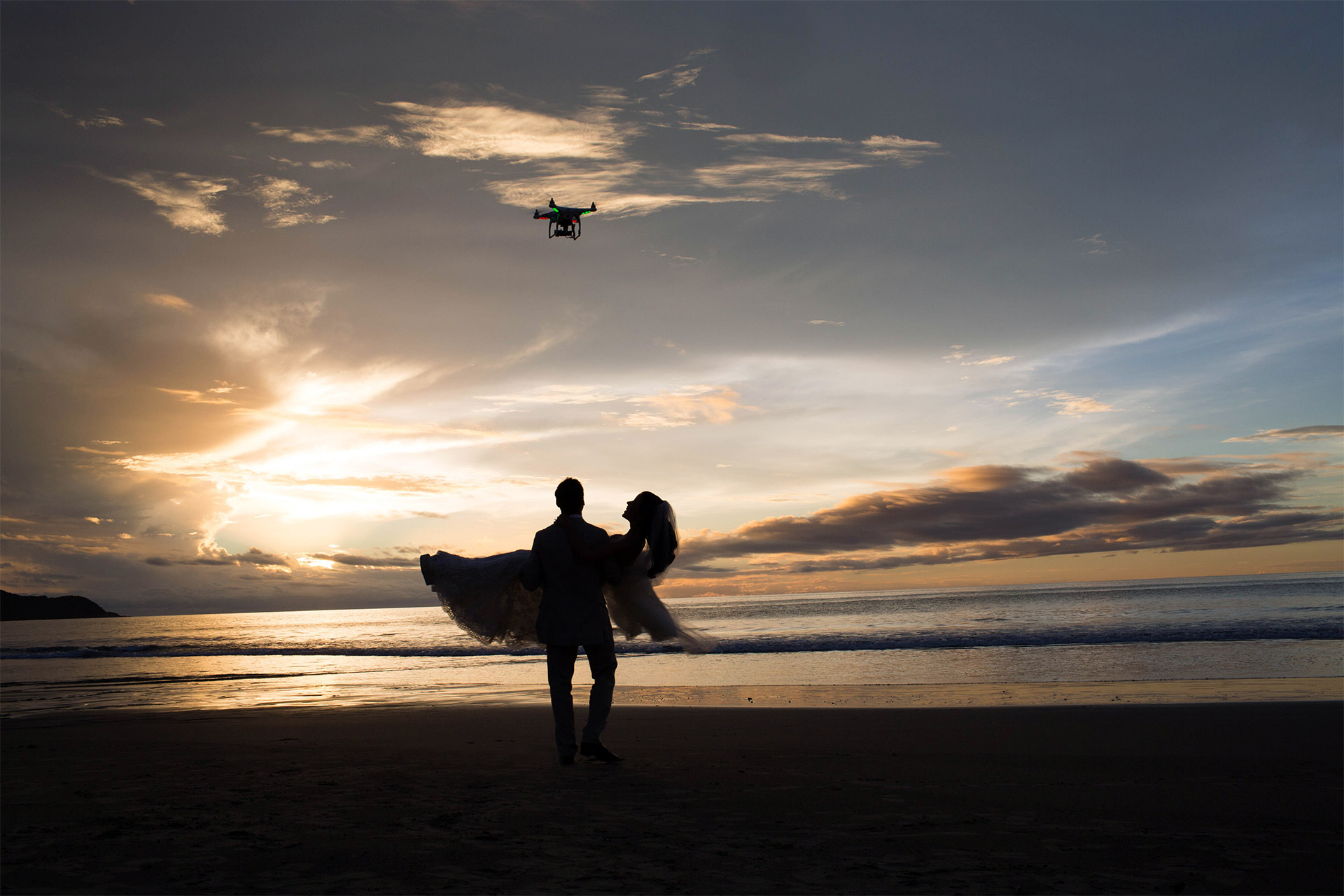 Aerial photograph of bride and groom on the beach